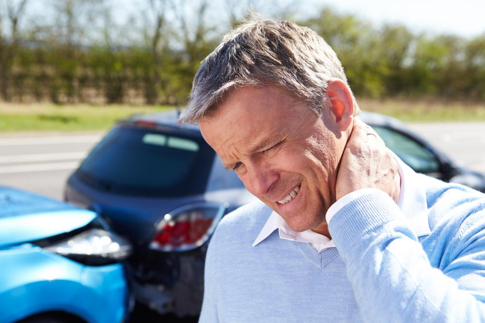 man with neck injury or whiplash after an auto accident before going to see rowland heights chiropractor