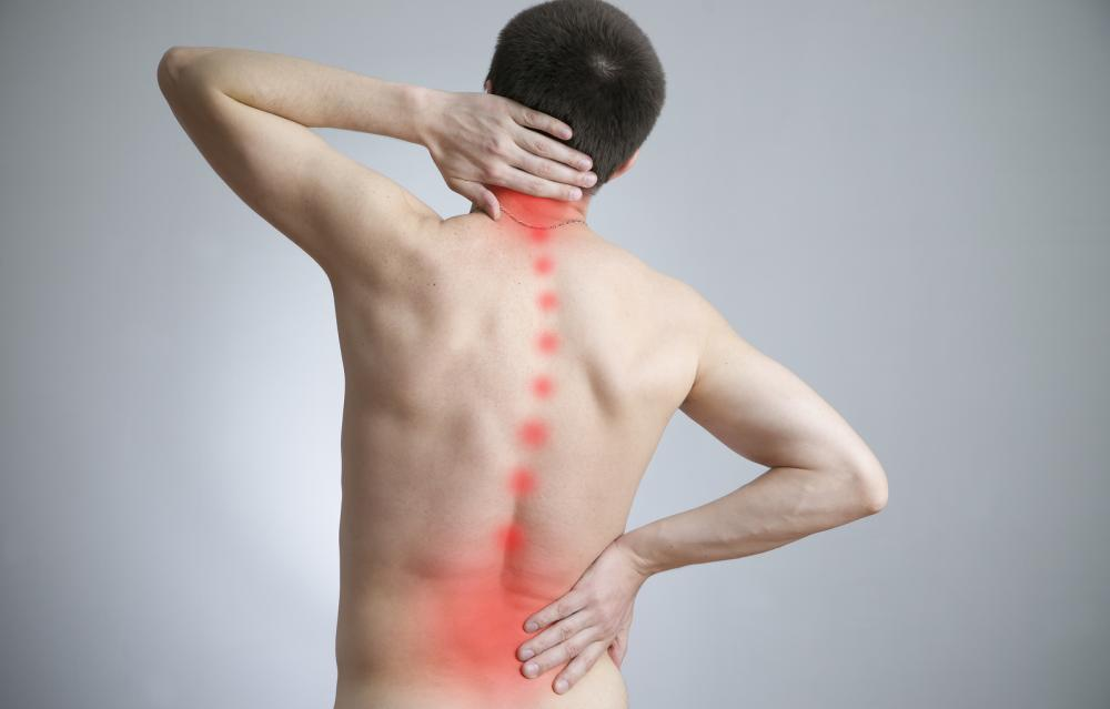 man with back pain before spinal decompression treatment with rowland heights chiropractor